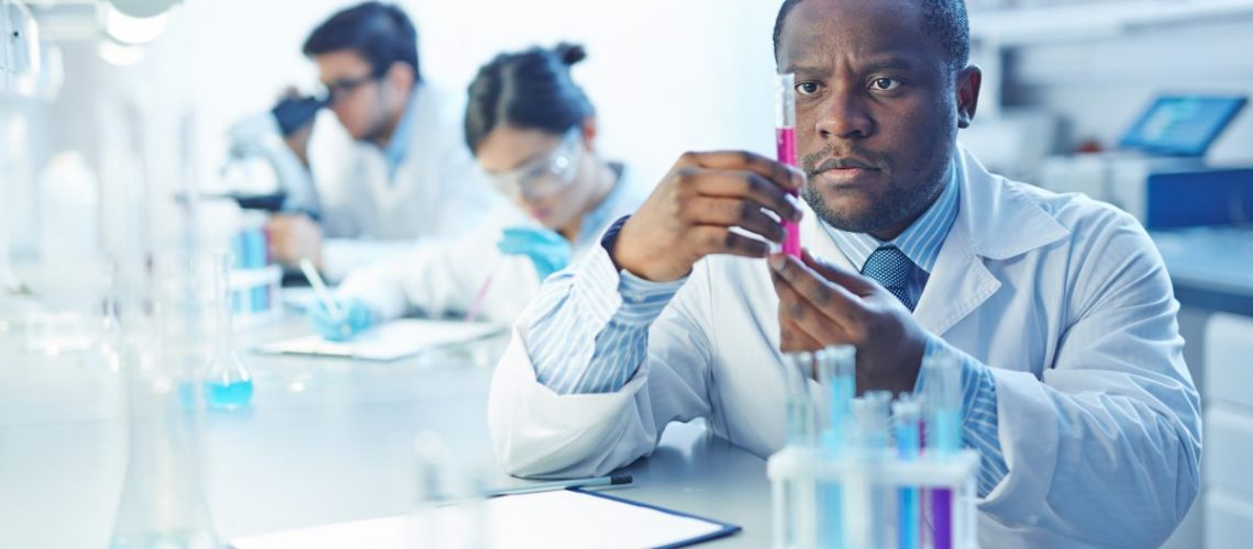 Serious assistant analyzing new virus in lab